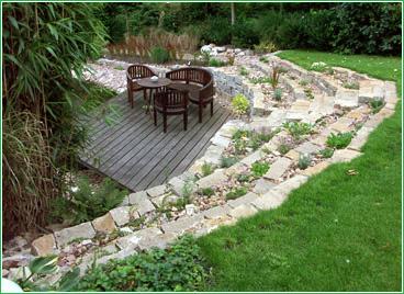gartenbau schramm oldenburg naturstein natursteinmauer. Black Bedroom Furniture Sets. Home Design Ideas
